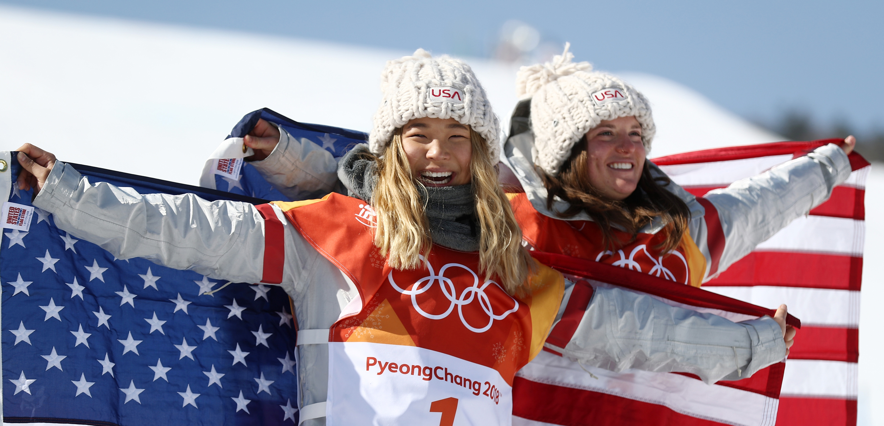 Gold medalist Chloe Kim and bronze medalist Arielle Gold celebrate following the halfpipe final at the 2018 Olympic Winter Games Tuesday. (Getty Images - Clive Rose)