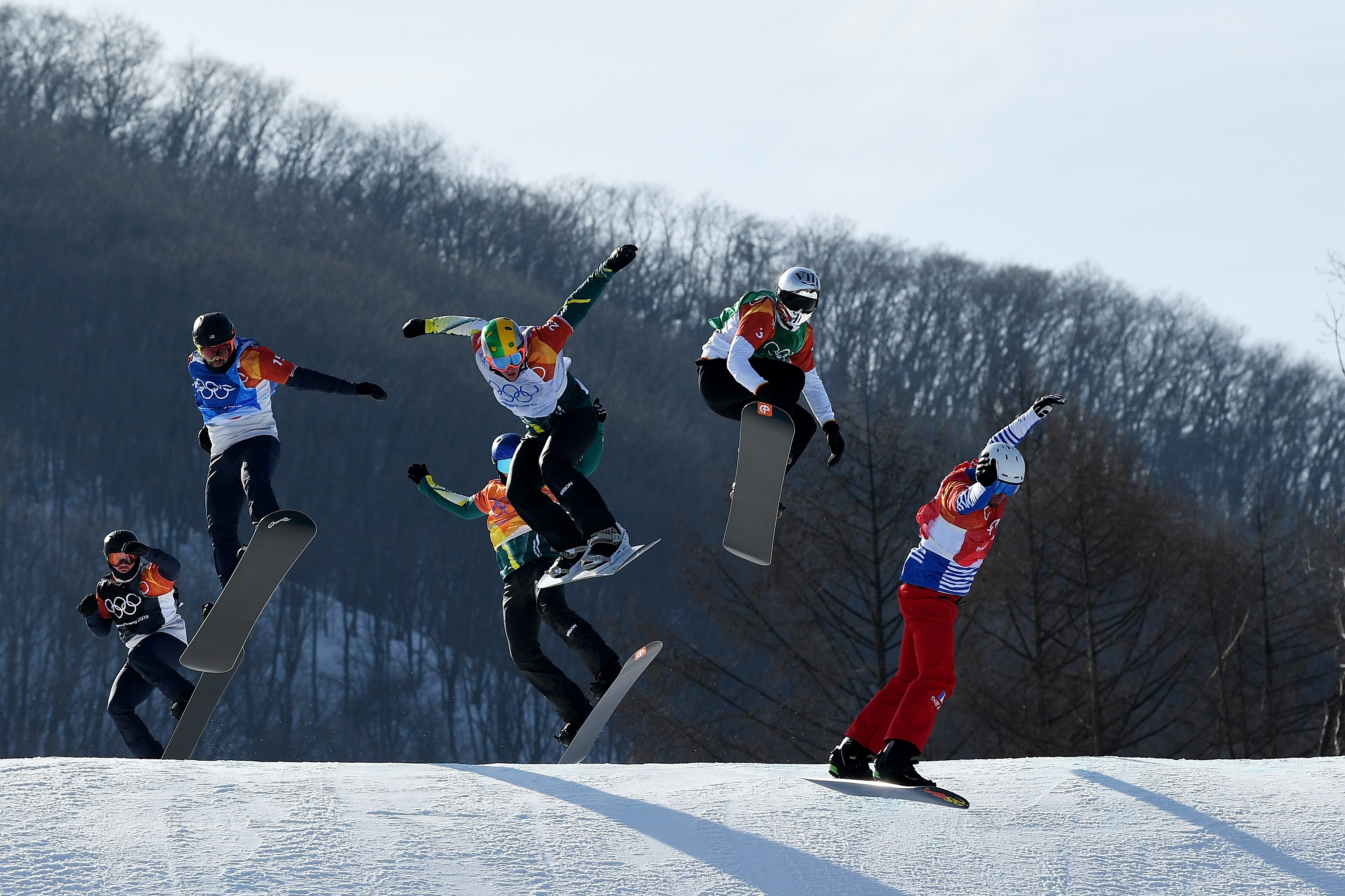 Nick Baumgartner (blue) and Mick Dierdorff (black) compete in the snowboardcross big final Thursday. (Getty Images - David Ramos)