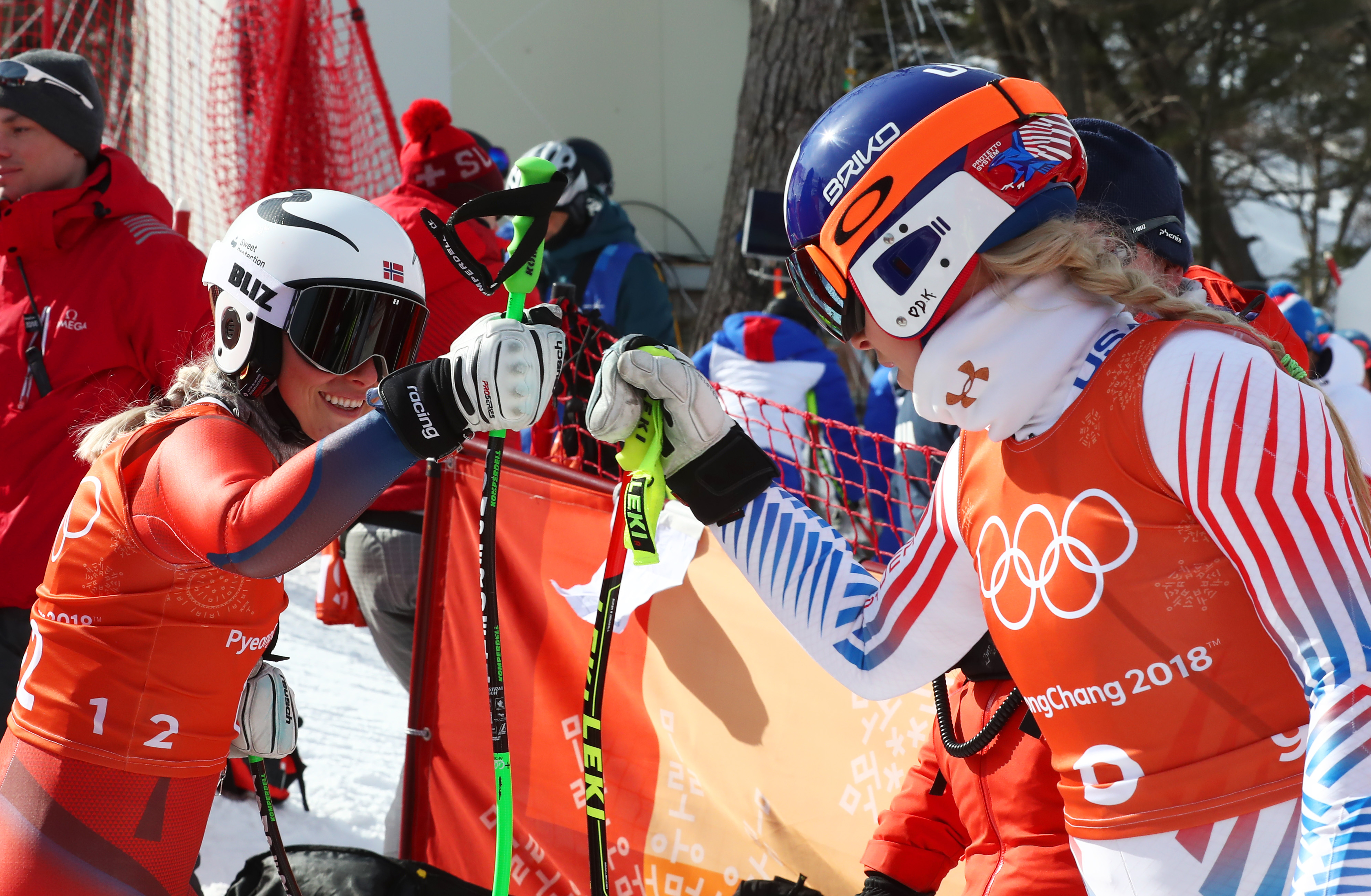 Lindsey Vonn and Ragnhild Mowinckel of Norway fist bump after the third training downhill training run Tuesday at Jeongseon Alpine Centre. (Getty Images - Alexander Hassenstein)