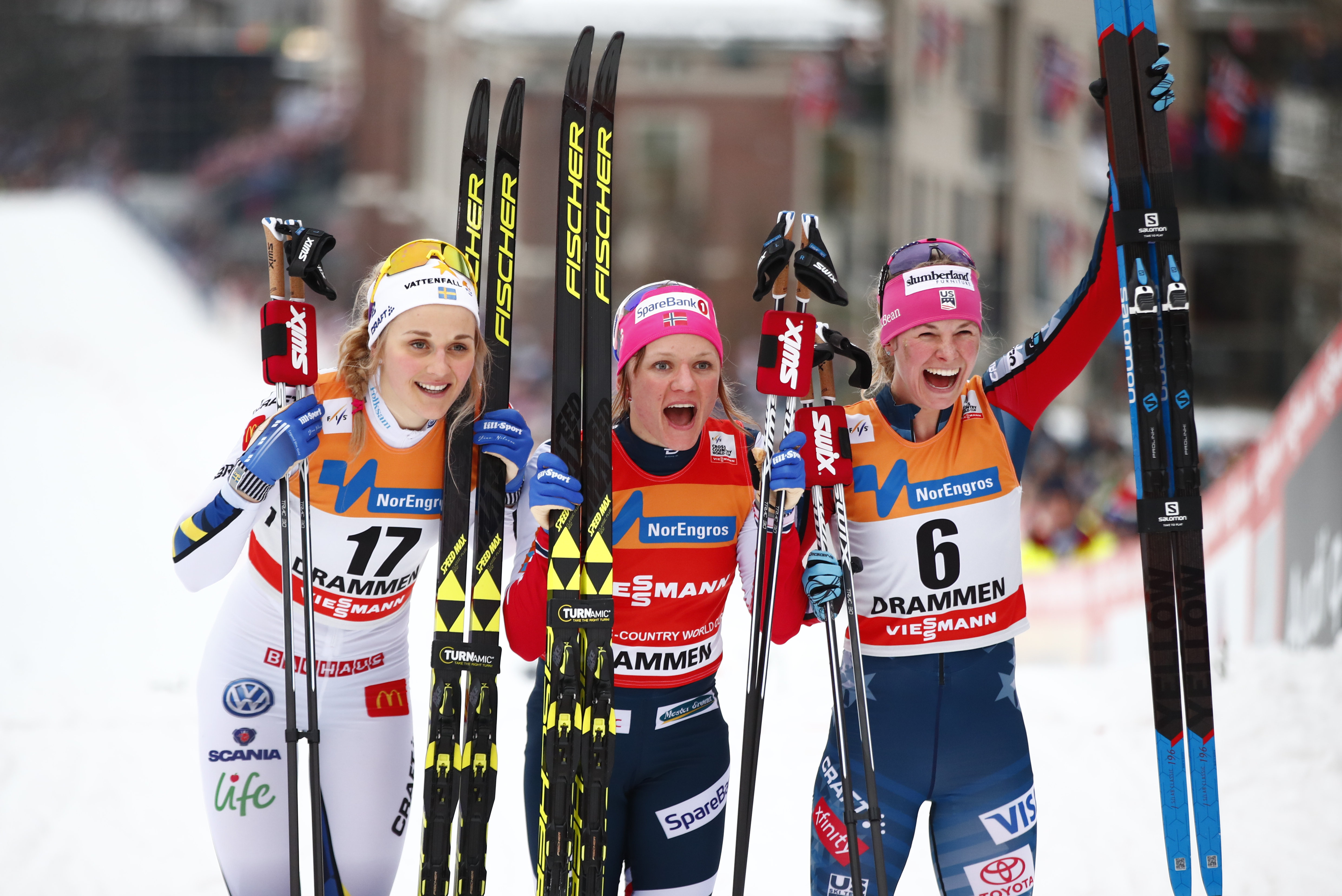 Jessie Diggins celebrates her first World Cup cross country classic sprint podium Wednesday in Drammen, Norway. Stina Nilsson of Sweden (left) was second, and Maiken Caspersen Falla of Norway took the victory. (Getty Images/AFP -  Terje Pedersen)