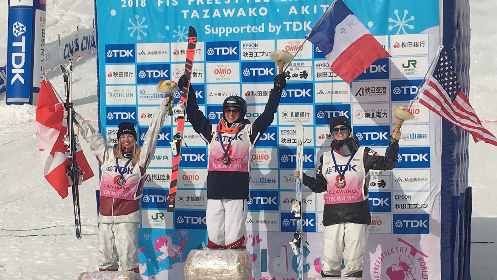 Keaton McCargo (right) celebrates her second career World Cup podium, a third place finish, with winner Perinne Laffont of France and second-place Justine Dufour-LaPointe of Canada.