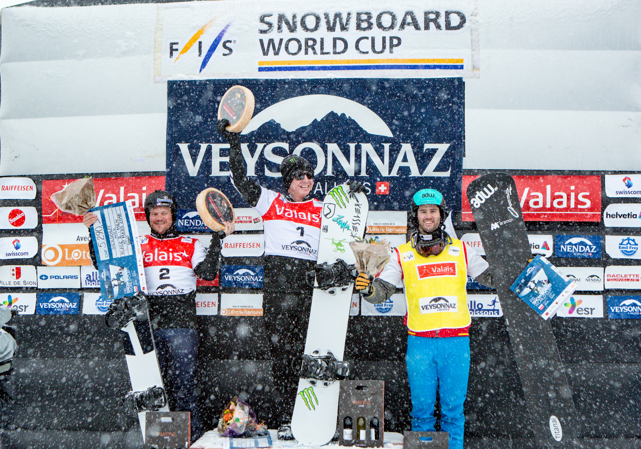 Nate Holland and Mick Dierdorff celebrate their 1-2 finish in Saturday's FIS Snowboardcross World Cup Veysonnaz, Switzerland. (FIS)