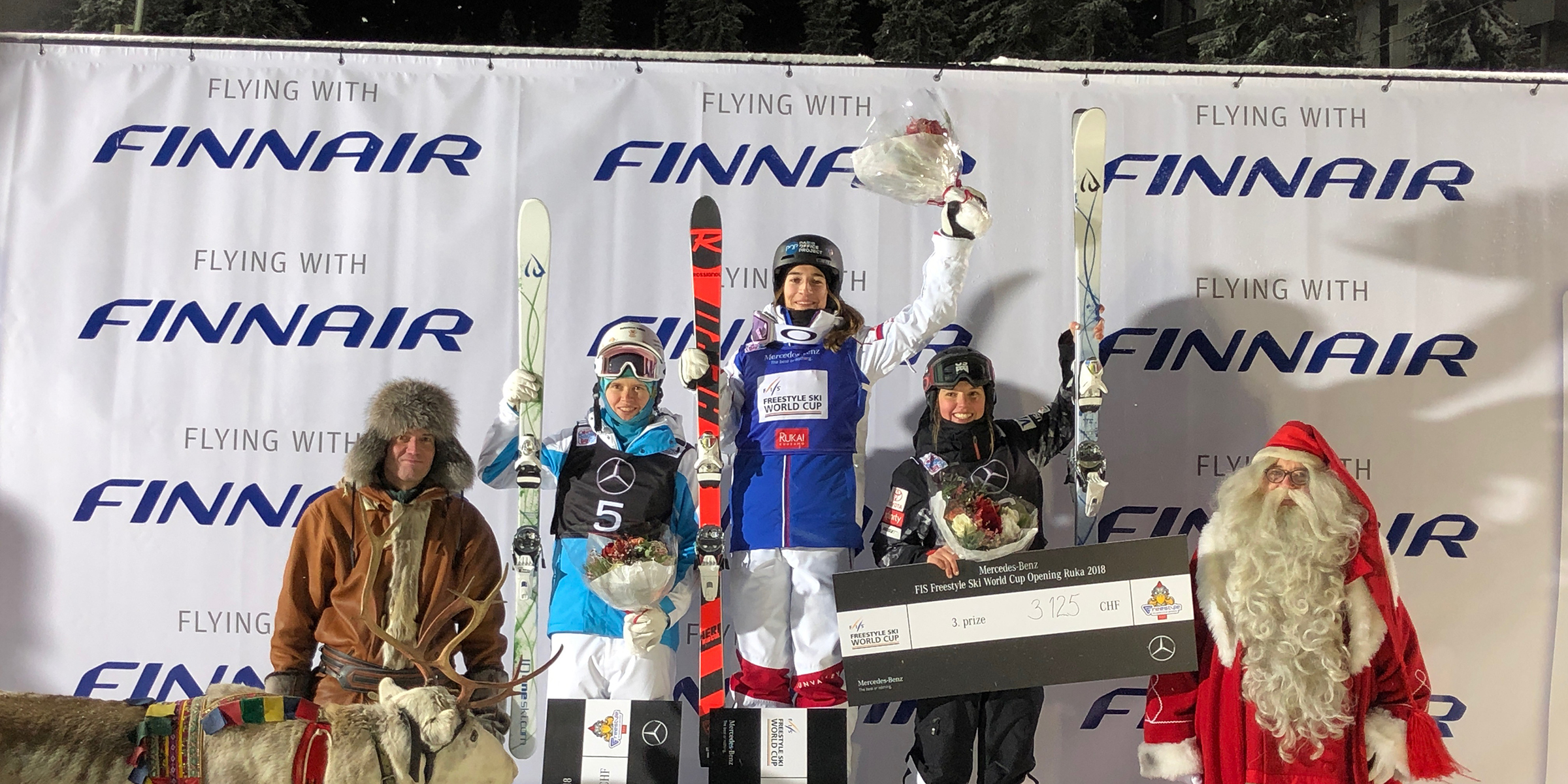 Tess Johnson, who took third in Friday's FIS Freestyle World Cup moguls event, shared the podium with France's Perrine Laffont, who came in first, and Kazakhstan's Yulia Galysheva, who came in second. (Matt Gnoza - U.S. Ski & Snowboard)