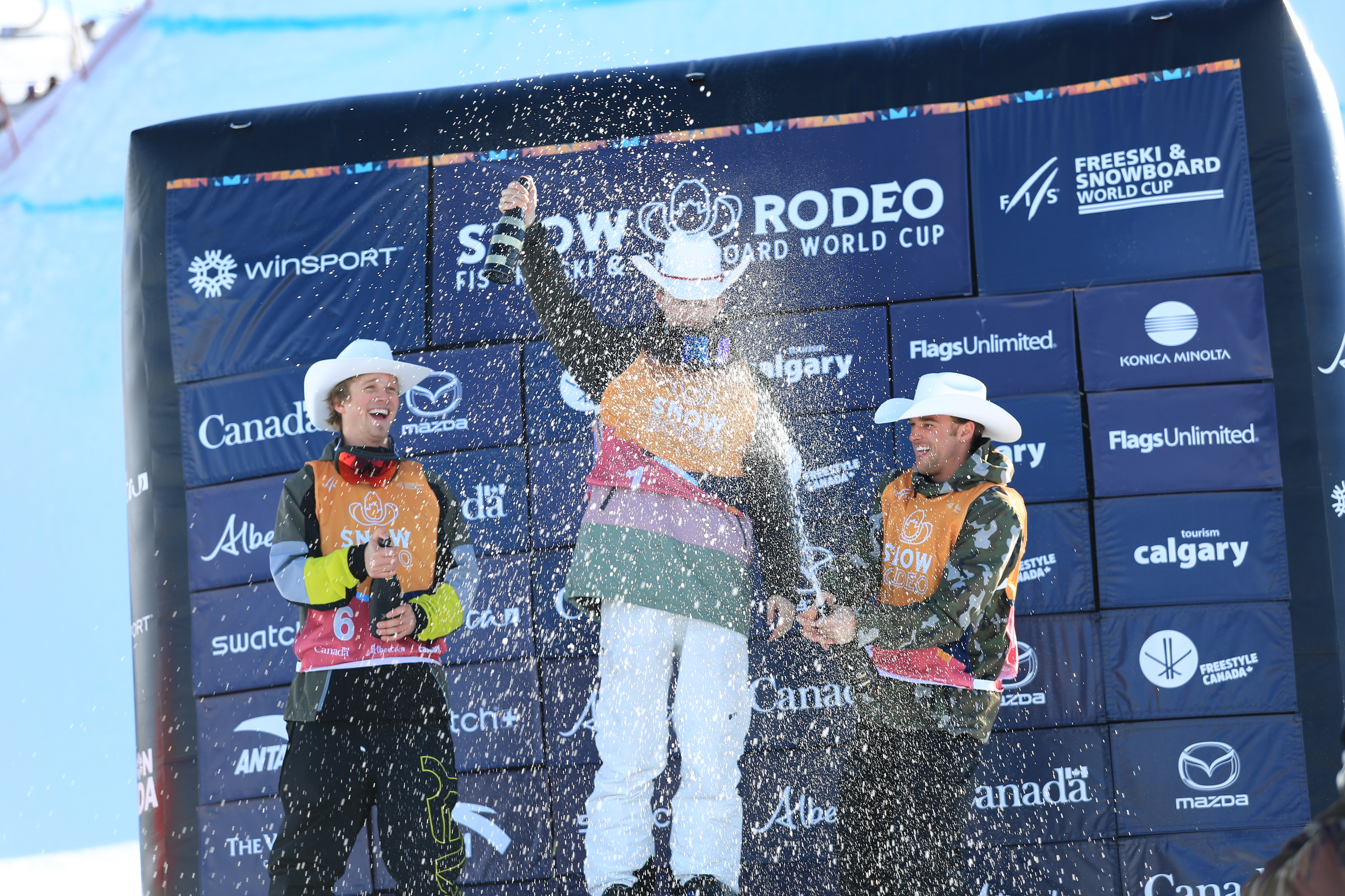 U.S Freeski Team Members Colby Stevenson (Left) and Nick Goepper (Right) stand atop the podium with Switzerland's Andri Ragettli (Center).