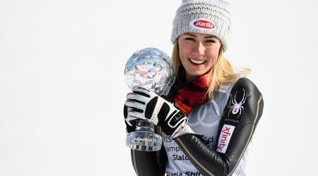 Shiffrin poses with her fifth slalom globe in six seasons.