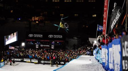 David Wise airborne at Mammoth Mountain Ski Area at night.